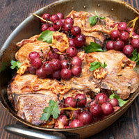 Pan Roasted Pork Chops with Crispy Prosciutto and Roasted Red Grapes