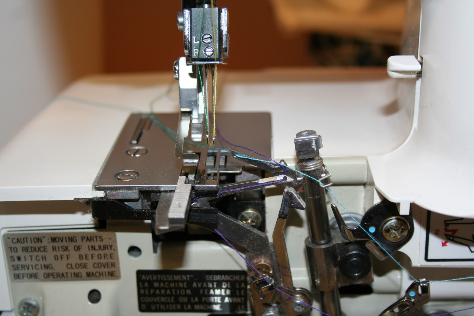 For this post, I manually threaded the loopers as well as the needles using  the same four colours of thread that the guide shows. This serger is easy  to ...