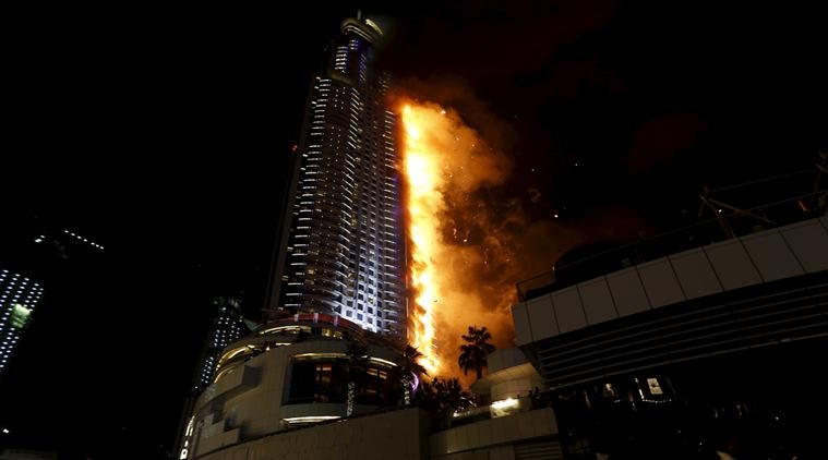 Shocking: Man Dangles From Balcony At 48 Storey As Fire Razes Down Dubai Skyscrapper