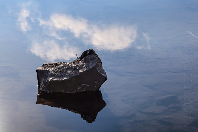 Robin Hood's Bay reflection of a rock and clouds by Martyn Ferry Photography