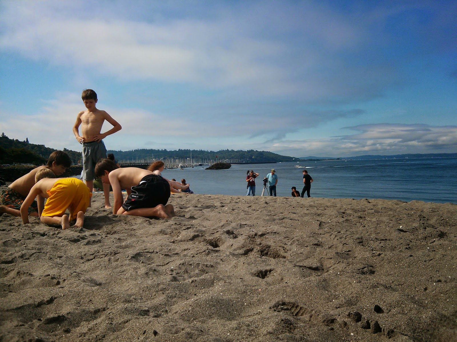 Extras: boys on the beach, on location for Mondo Beacho.  In the background: Emily Purington and Mondo Beacho crew