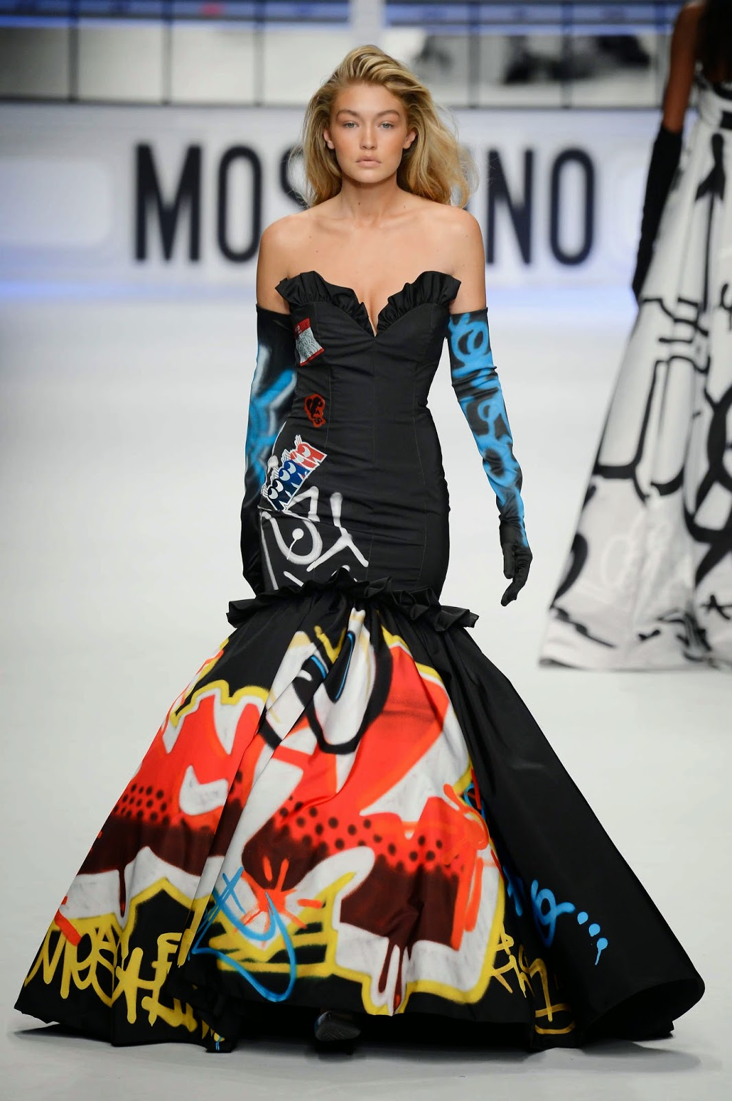 Gigi Hadid models vibrant designs for the Moschino Fall/Winter 2015 London Fashion Week Show
