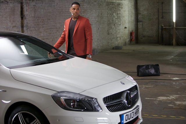 Reggie Yates and a white Mercedes-Benz A250 during Mercedes-Benz Fashion Week London