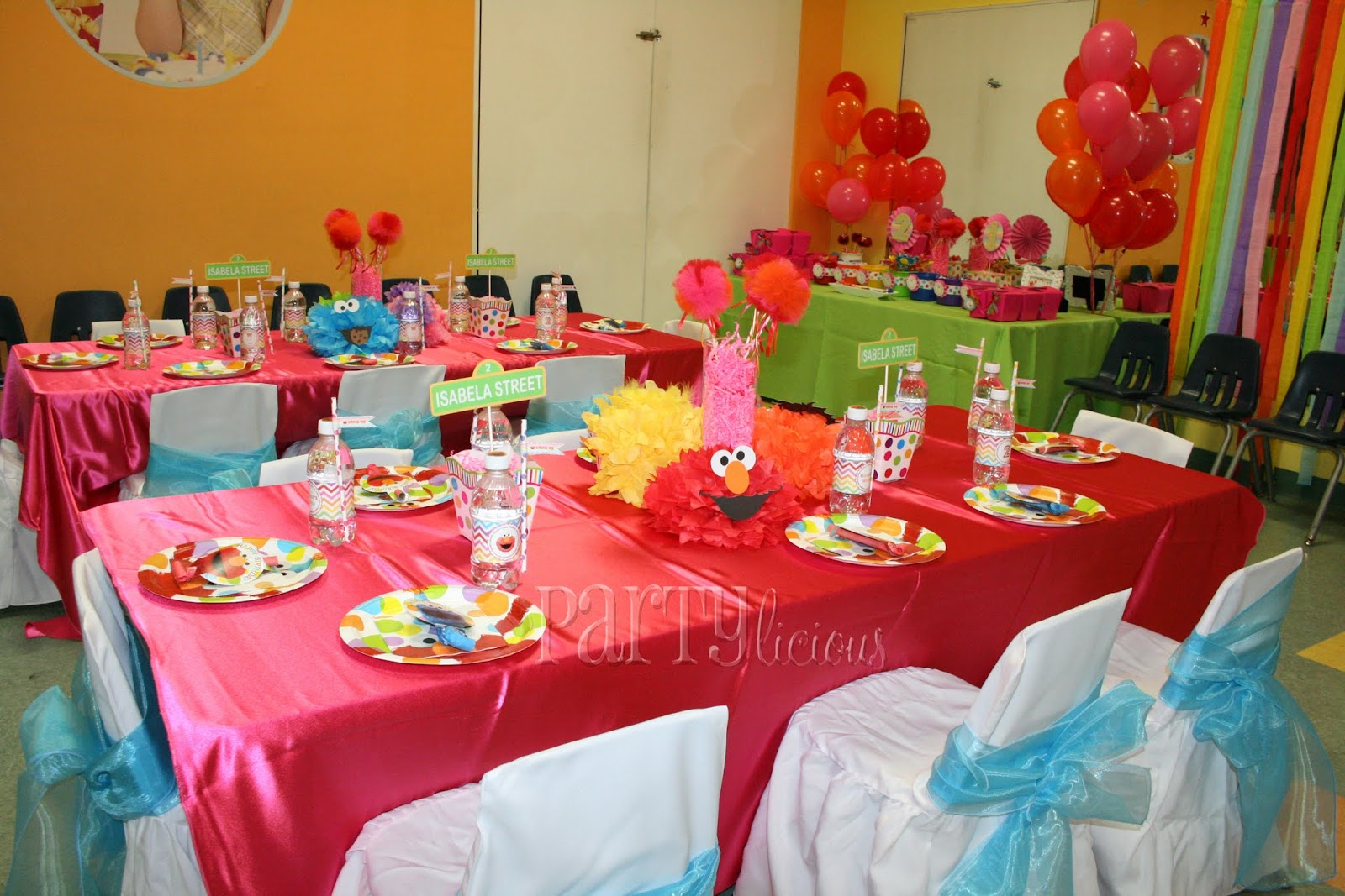The Kids Tables Had Amazing Centerpieces With Tulle Pom Wands Created By Mare And Tissue Poms Faces Of Sesame Street Characters