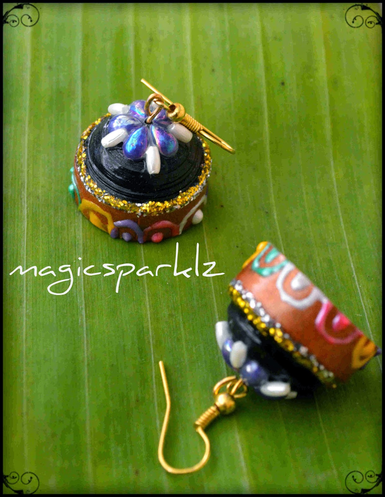 grand look quilled black jhumka