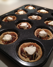 Caramelized Onion and Chevre tartlets with dollop of chevre on top