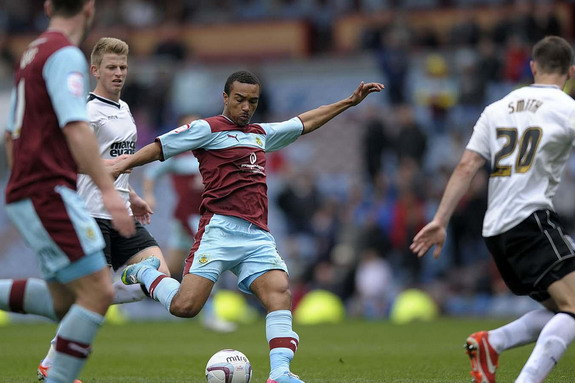 Burnley player Junior Stanislas shoots to score from long range against Ipswich