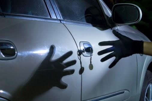 Hand reaching for key in car door