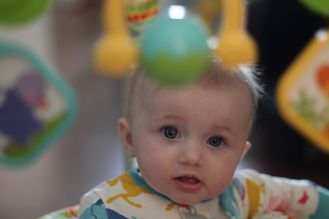 baby in fisher price jumperoo