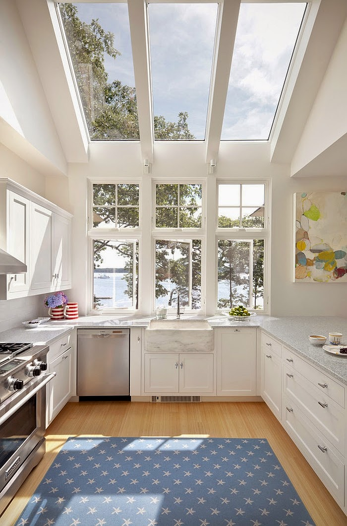Contemporary kitchen in white opens up towards the view outside