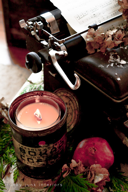 Candle in vintage coffee tin, with old typewriter decked out for Christmas, by Funky Junk Interiors