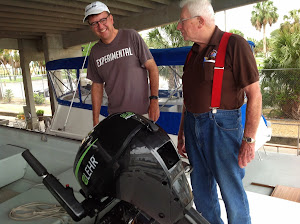 Hugh and Fred admire Chucky's  Propane motor. No more gasoline!