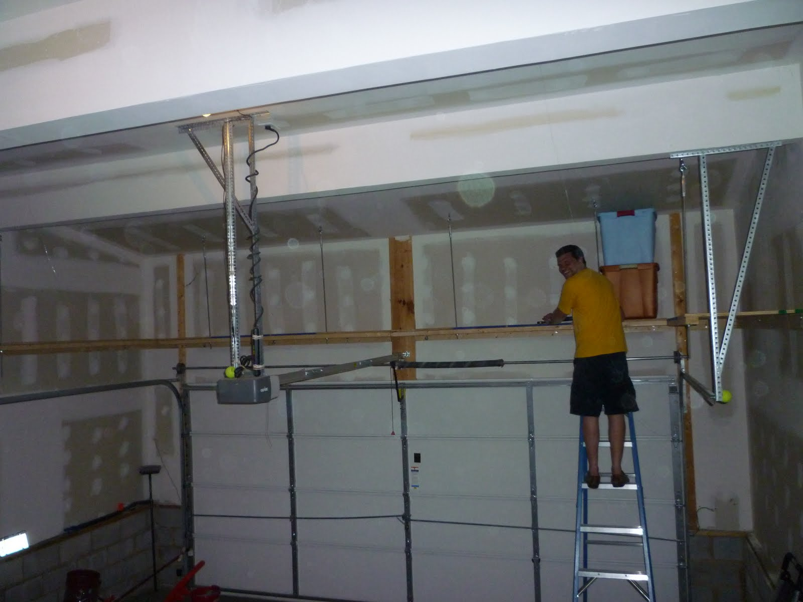 Building Storage Shelves above Garage Doors