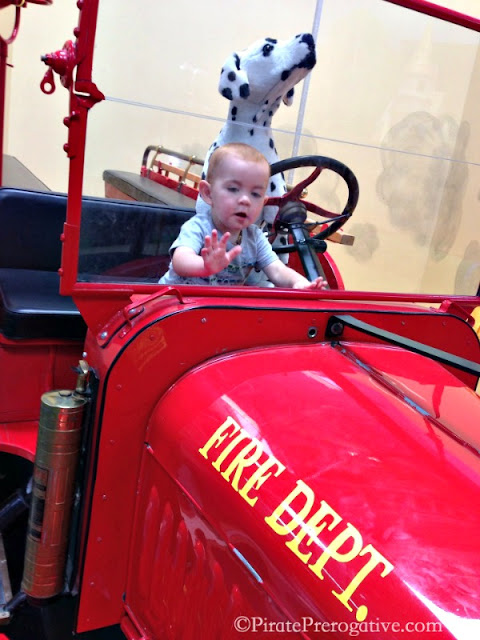 Playing in the fire truck at KidVentures 4S Ranch