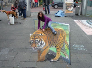 girl riding tiger optical illusion