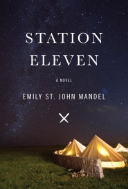 Cover of Station Eleven, featuring four white canvas tents arranged behind a very low stone wall and lit from within. Above them is a dark blue sky studded with a fantastic amount of stars.