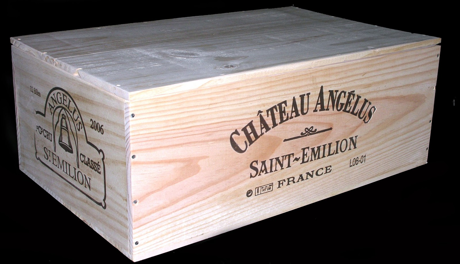 The Chateau Angelus is actually a crate from Bordeaux. Not Burgundy. This  is an example of how wooden wine box designs and descriptions can be subtle.