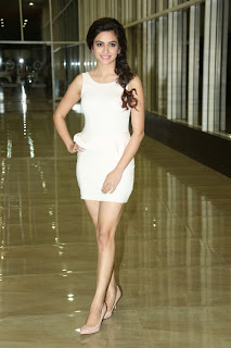 Kriti Kharbanda Lovely Short Tight Light Pink Dress @ Lakshmi Raave Maa Intiki audio Launch