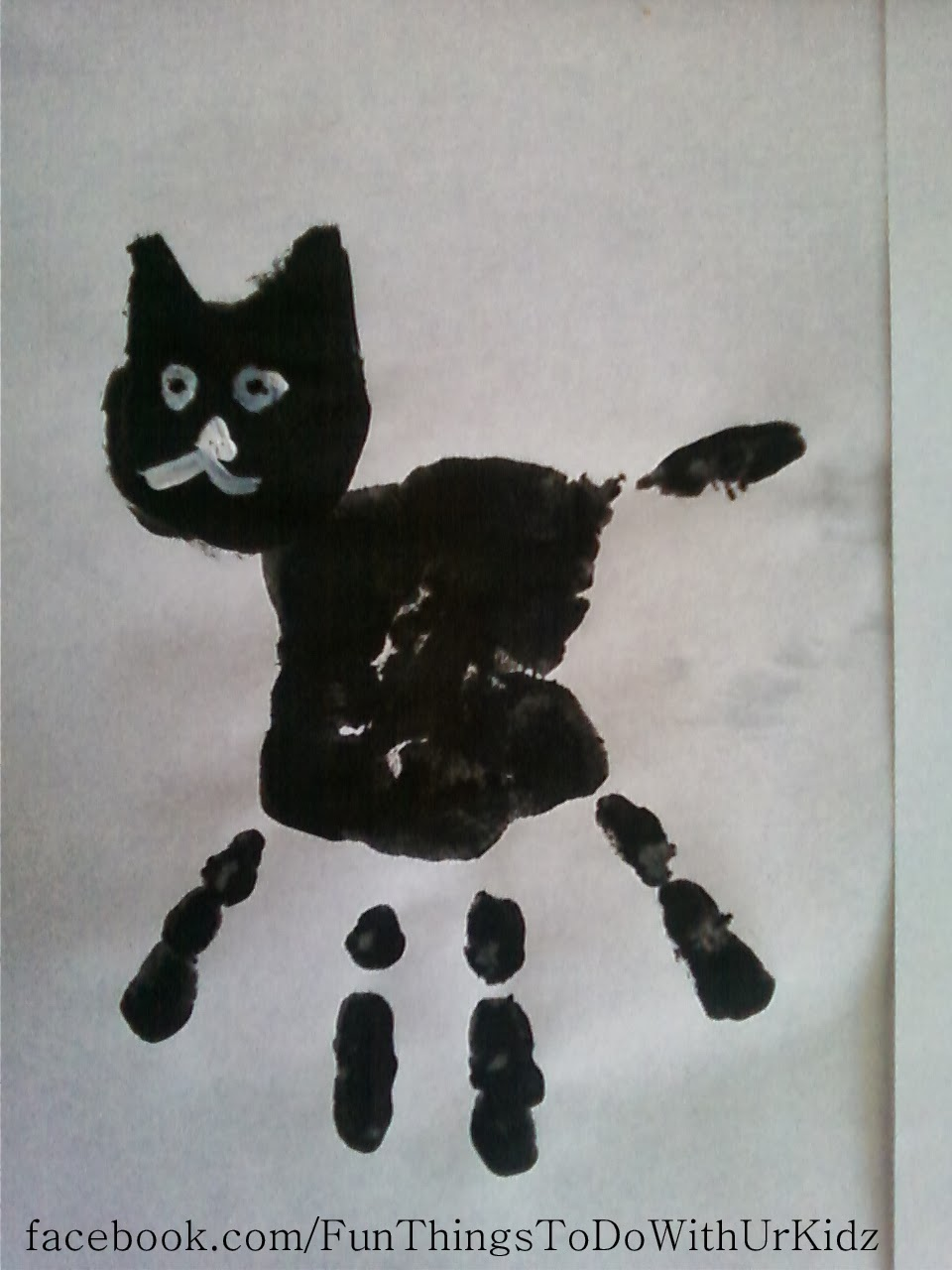 Black cat hand prints for Cat crafts for toddlers