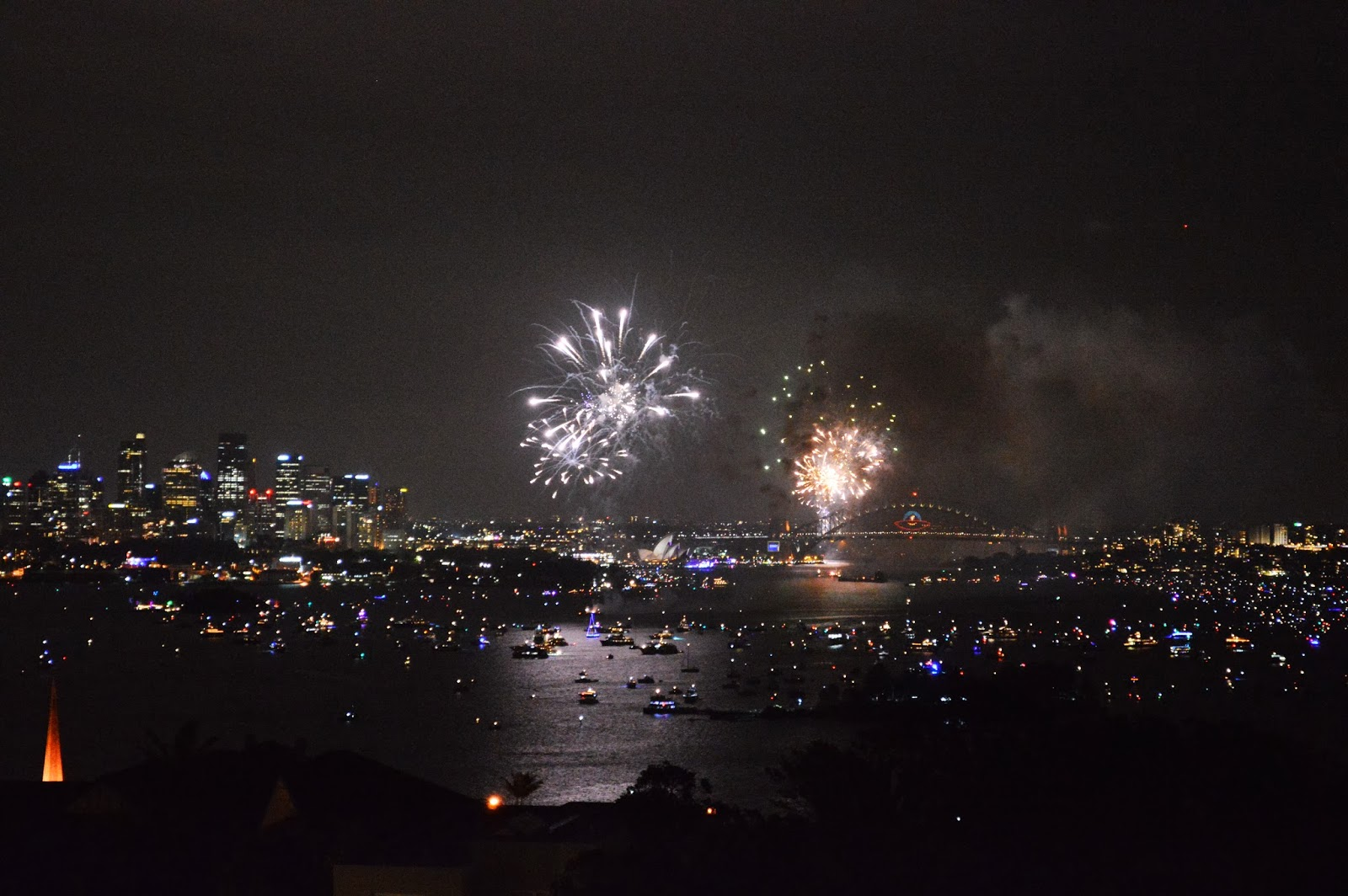 Fireworks exploding over the Sydney Harbor on New Years Eve.