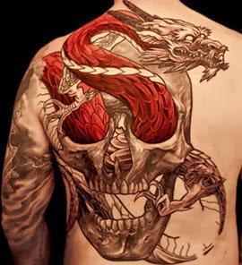 Fotos de tatuagens de dragão nas costas com caveira