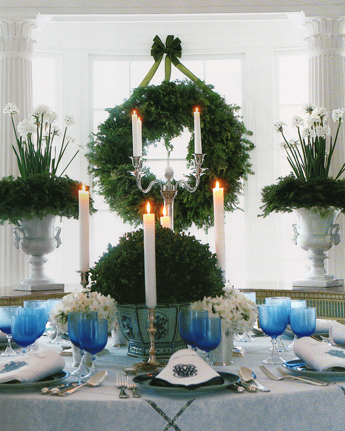 Carolyn Roehm uses blue and white, boxwood, Paperwhites, and monogrammed linens to create a spectacular Christmas table