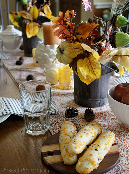Golden Autumn Tablescape with rustic fall bucket arrangements