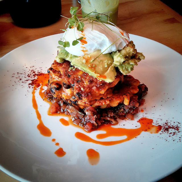Corn and black bean fritters, chimichurri, avocado and a poached egg