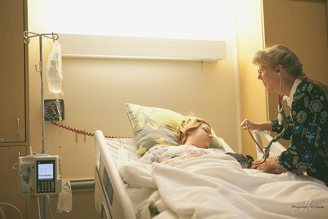 Beloit Kansas - nurse checking on the mother