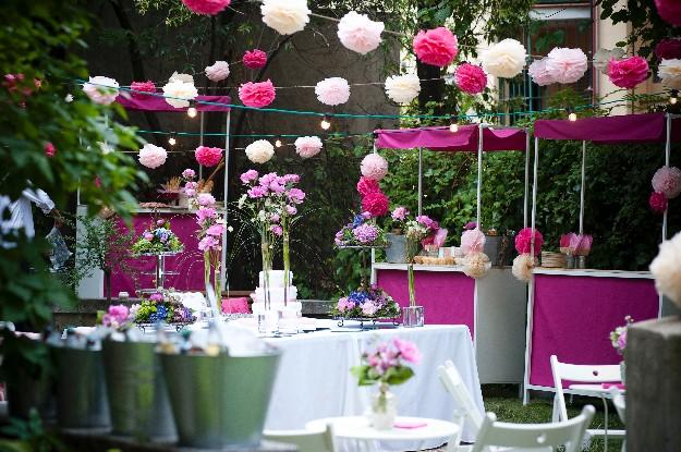Bautizo con pompones rosas de Caritina Goyanes