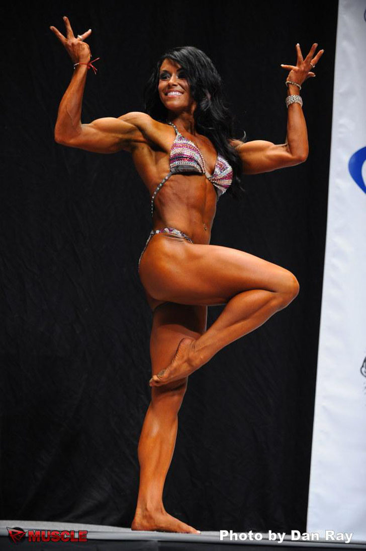 Laura Gutilla Flexing Her Muscles At The 2012 NPC USA Championships