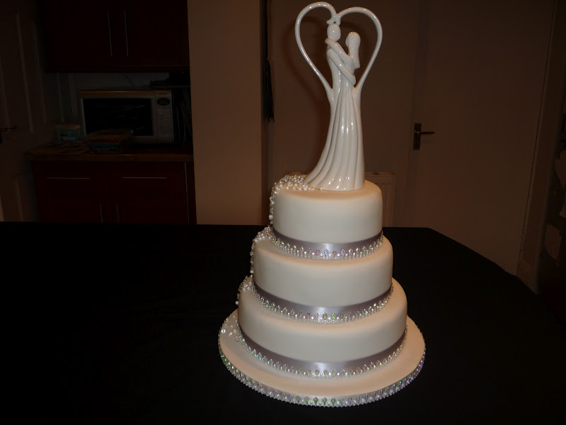 A bit of bling wedding cake diamonds pearls and crystals