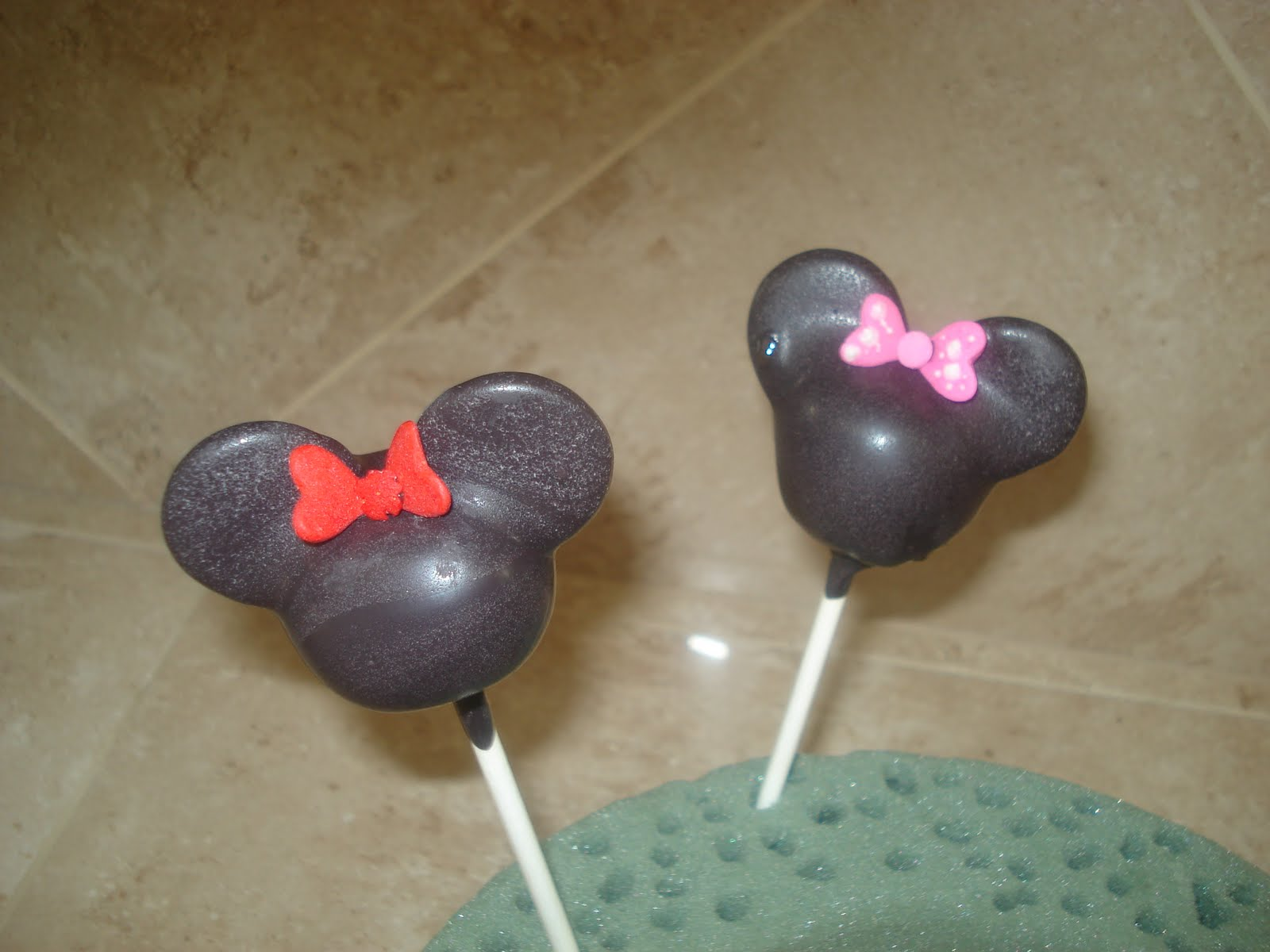 minnie mouse with red hair bow and ribbon mickey mouse with black