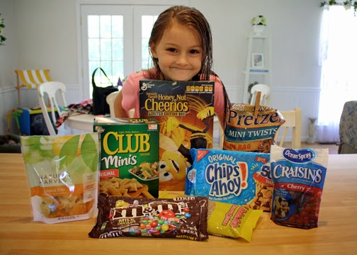 Tessa chose Honey Nut Cheerios, mini pretzels, mini Club crackers, chocolate chip cookies, M&Ms, sunflower seeds, cherry-flavored Craisins, and dried tropical fruit for her trail mix. My original plan was to take her to Dollar Tree and let her pick out $5-$6 worth of similar product. We don't have one local, so Tessa's trail mix ended up costing a good bit more than I intended.