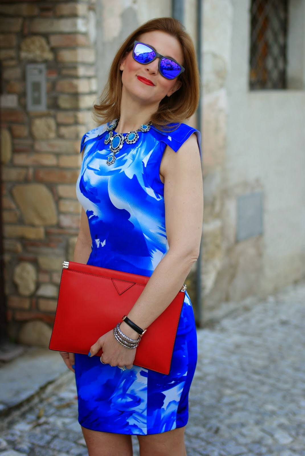 Red clutch, blackfive dress, Oakley blue mirror sunglasses, Fashion and Cookies, fashion blogger