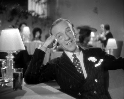 Fred Astaire chills out watching the Xaviar Cugat Band in You Were Never Lovelier, Columbia 1942