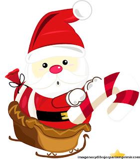 Santa claus en su trineo con caramelos de navidad