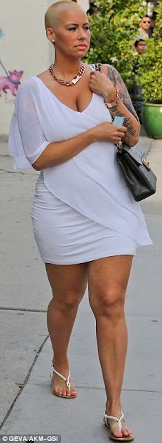 Stunning Amber Rose steps out in white