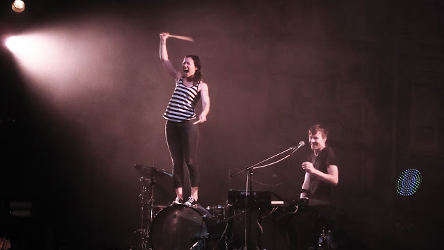 Kim, of Matt and Kim, standing on her drum during a performance at the Ogden Theater in Denver.