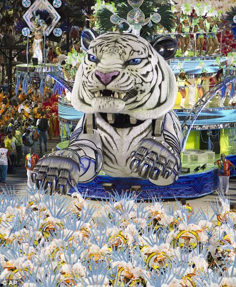 Flying tiger performers from the Inocentes de Belford Roxo samba school parade.