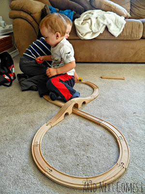 Number 8 made from wooden train tracks from And Next Comes L