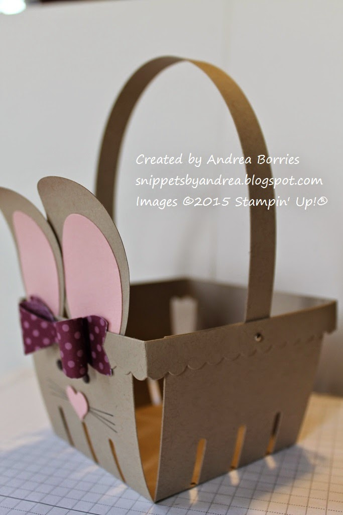 Bunny Basket Step 11. Use mini silver brads to attach the handle to the basket.