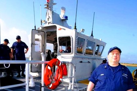 Bob Daraio on the dock by the 45' Medium Response Boat. USCG Aux photo by Greg Porteus
