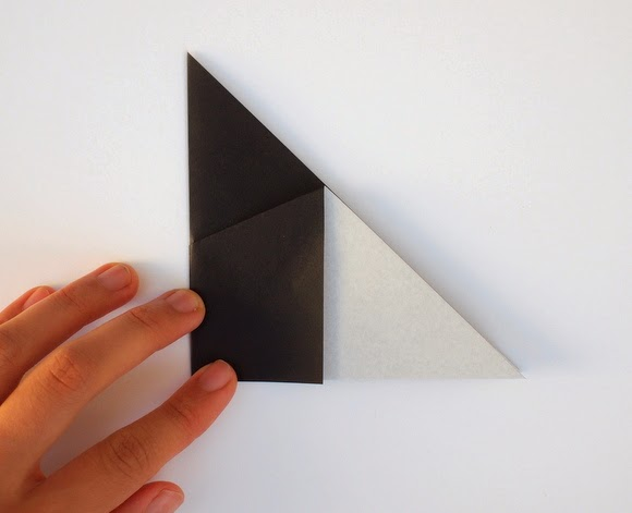 fold triangle in half bring left corner of the triangle underneath