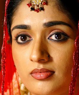 kavya madhavan face