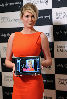 Kate Upton holding Samsung Galaxy Note 10.1
