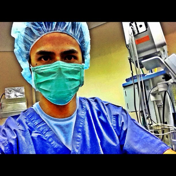 Dina Bonnevie and Oyo Boy Sotto were in scrub suits taking pictures in