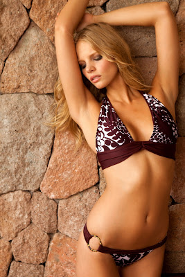 Marloes Horst showing off her perfect body in Sauvage swimwear