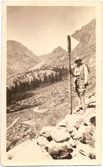 woman standing on rocks in mountains possibly Sierra Nevadas in California circa late 1920s