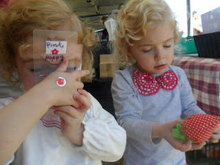Two girls at a local strawberry fair.